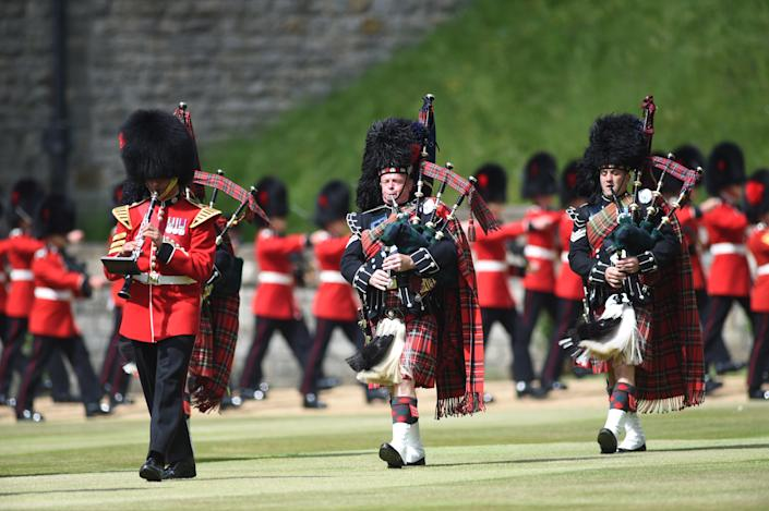 Members of the Massed Band of the Household Division during a ceremony at Windsor Castle in Berkshire to mark her official birthday. Picture date: Saturday June 12, 2021.