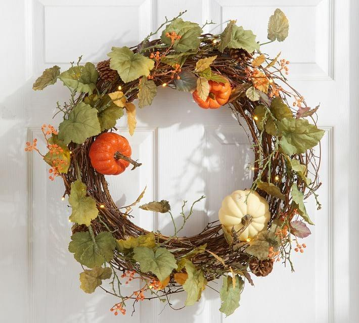 <p>The <span>Lit Natural Pumpkin Wreath and Garland</span> ($129-$149) features gourds, pumpkins, berries, and flowers.</p>