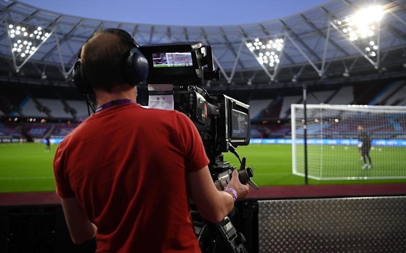 A TV Camera man films the warm-up prior to the Premier League match between West Ham United and Newcastle United - GETTY IMAGES
