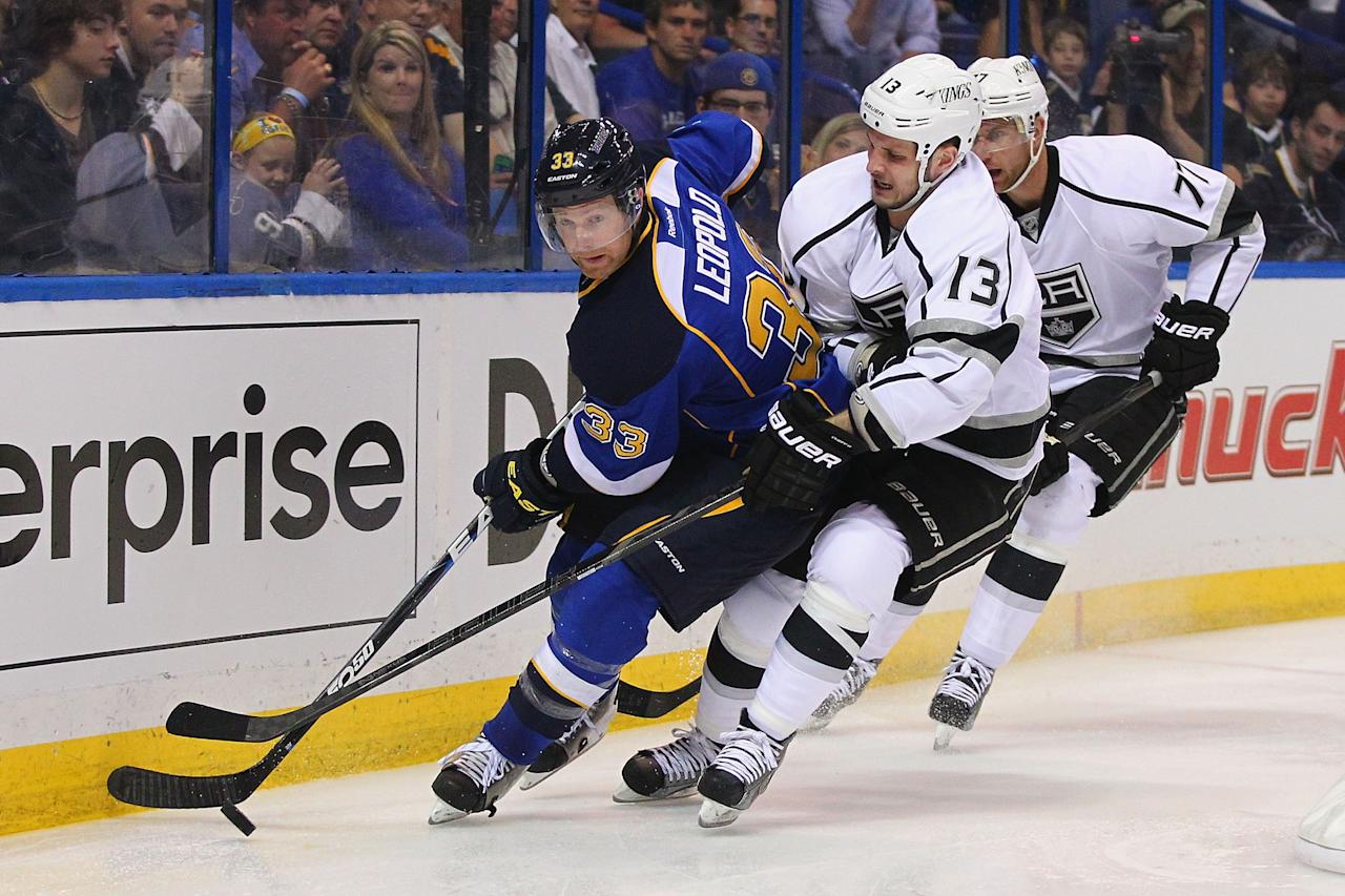 ST. LOUIS, MO - APRIL 30: Kyle Clifford #13 of the Los Angeles Kings looks to steal the puck from Jordan Leopold #33 of the St. Louis Blues in Game One of the Western Conference Quarterfinals during the 2013 NHL Stanley Cup Playoffs at the Scottrade Center on April 30, 2013 in St. Louis, Missouri.  (Photo by Dilip Vishwanat/Getty Images)