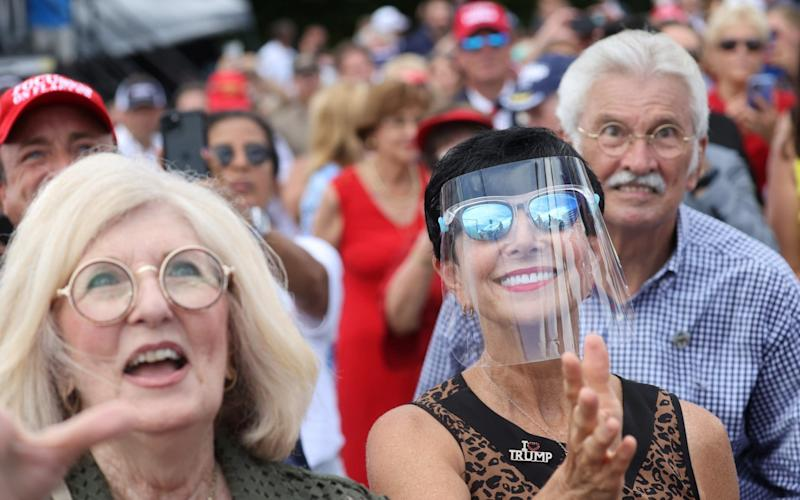Florida supporters of U.S. President Donald Trump, with few of them wearing masks because of the coronavirus disease (COVID-19) pandemic, - Reuters