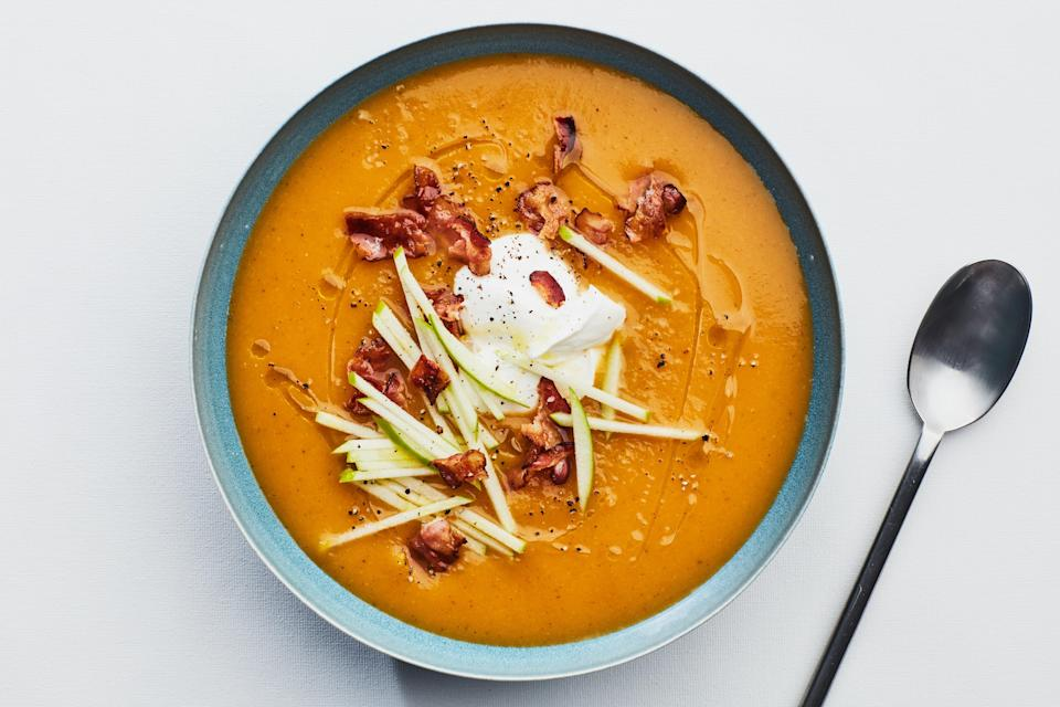 """If you want to celebrate the bountiful harvest right, you're going to need some <a href=""""https://www.epicurious.com/ingredients/best-butternut-squash-recipes?mbid=synd_yahoo_rss"""" rel=""""nofollow noopener"""" target=""""_blank"""" data-ylk=""""slk:butternut squash"""" class=""""link rapid-noclick-resp"""">butternut squash</a>. This easy soup is made without cream—the squash itself provides plenty of silky texture. Serve it as an appetizer before the parade of turkey and stuffing begins. <a href=""""https://www.epicurious.com/recipes/food/views/butternut-squash-apple-soup-365210?mbid=synd_yahoo_rss"""" rel=""""nofollow noopener"""" target=""""_blank"""" data-ylk=""""slk:See recipe."""" class=""""link rapid-noclick-resp"""">See recipe.</a>"""