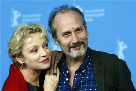 """Cast members Caroline Silhol (L) and Hippolyte Girardot pose during a photocall to promote the movie """"Aimer, Boire Et Chanter"""" (Life of Riley) at the 64th Berlinale International Film Festival in Berlin February 10, 2014. REUTERS/Thomas Peter"""