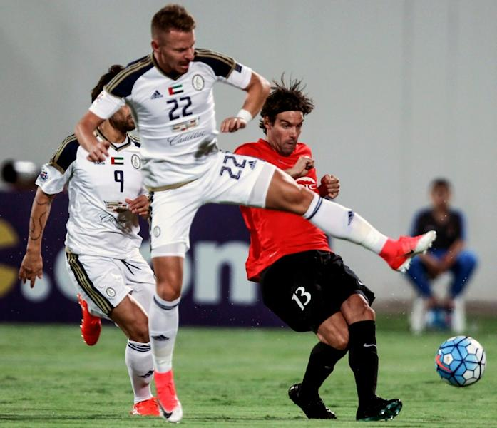 UAE Al-Wahda FC's Hungarian midfielder Balazs Dzsydzsak vies for the ball against Uruguayan Gonzalo Viera of Qatar's al-Rayyan SC during their AFC Champions League group D football match at Al-Nahyan Stadium in Abu Dhabi on April 24, 2017