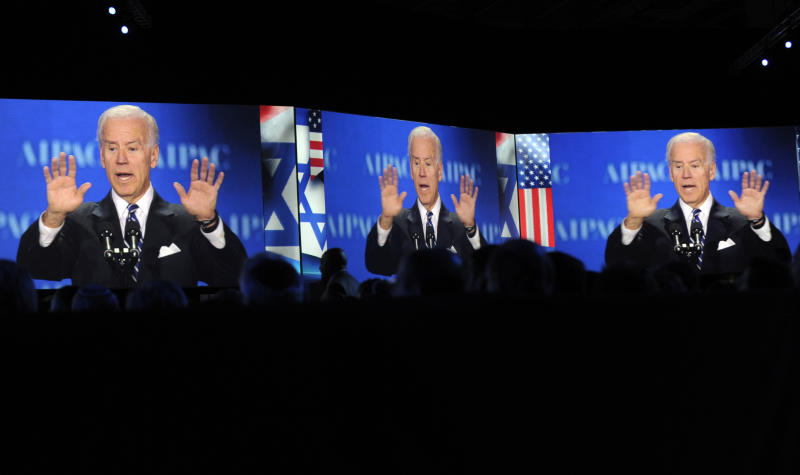 Vice President Joe Biden, projected on screens, gestures as he addresses the American-Israeli Public Affairs Committee (AIPAC) 2013 Policy Conference, Monday, March 4, 2013, at the Walter E. Washington Convention Center in Washington.  (AP Photo/Susan Walsh)