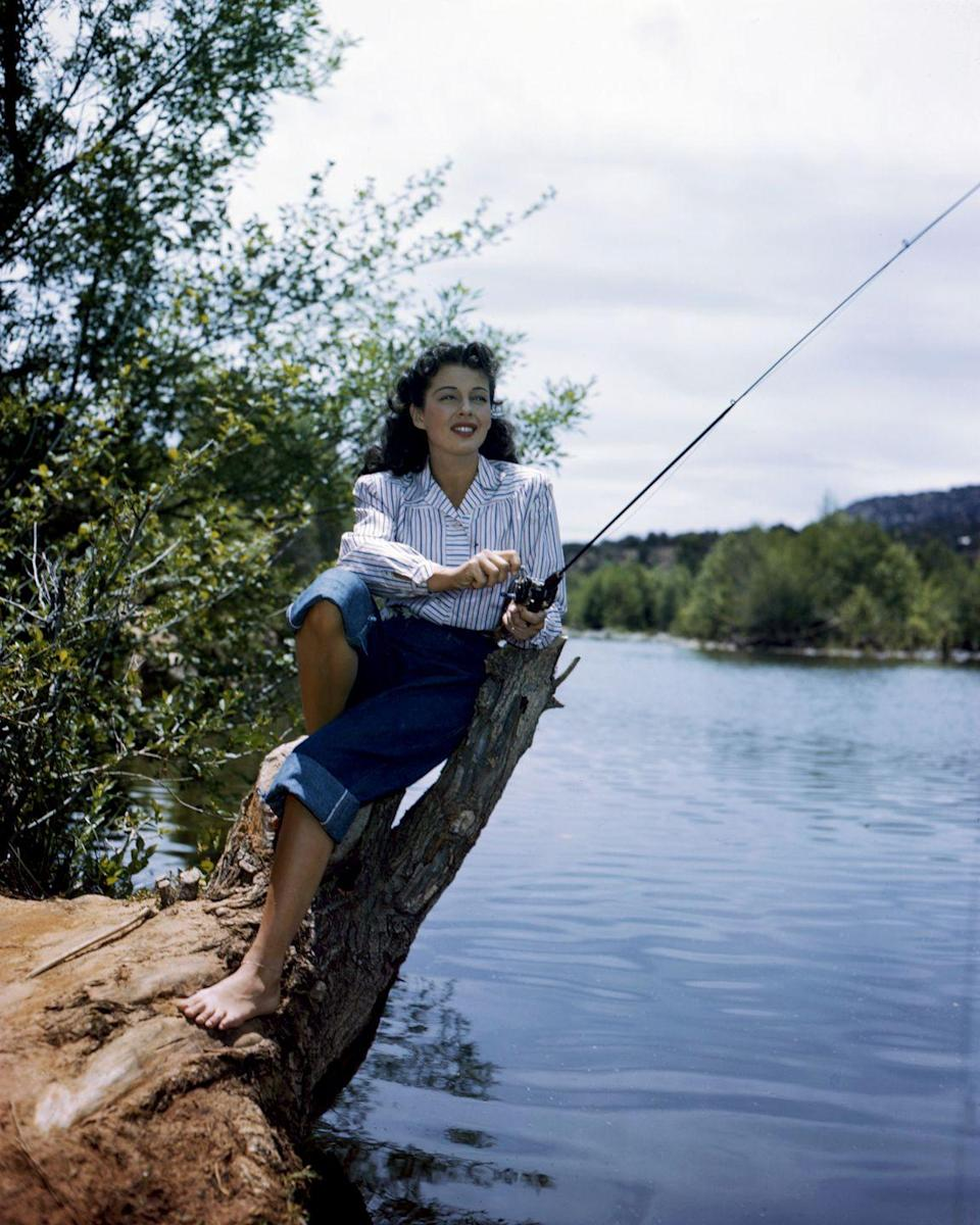 <p>Actress Gail Russell also wears boxy, cuffed jeans for outdoor activities.</p>