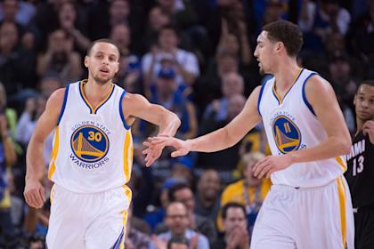Curry (left) and Thompson have led the Warriors to the NBA's best record at the All-Star break. (USA Today)