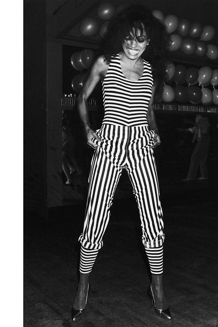 <p>Diana Ross in a striped jumpsuit for a night out at the Embassy Nightclub in London. </p>