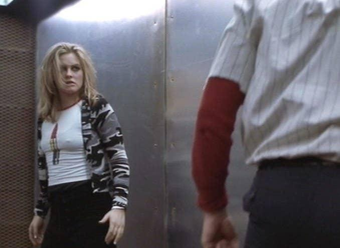 Emily stands looking at Vincent with a fierce look on her face in Excess Baggage