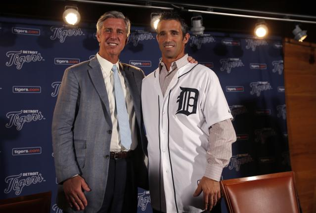 Detroit Tigers General Manager Dave Dombrowski (L ) and newly named Tigers manager Brad Ausmus pose together during a press conference where Ausmus was named the 37th manager in franchise history of the Tigers in Detroit, Michigan November 3, 2013. REUTERS/Rebecca Cook (UNITED STATES - Tags: SPORT BASEBALL)