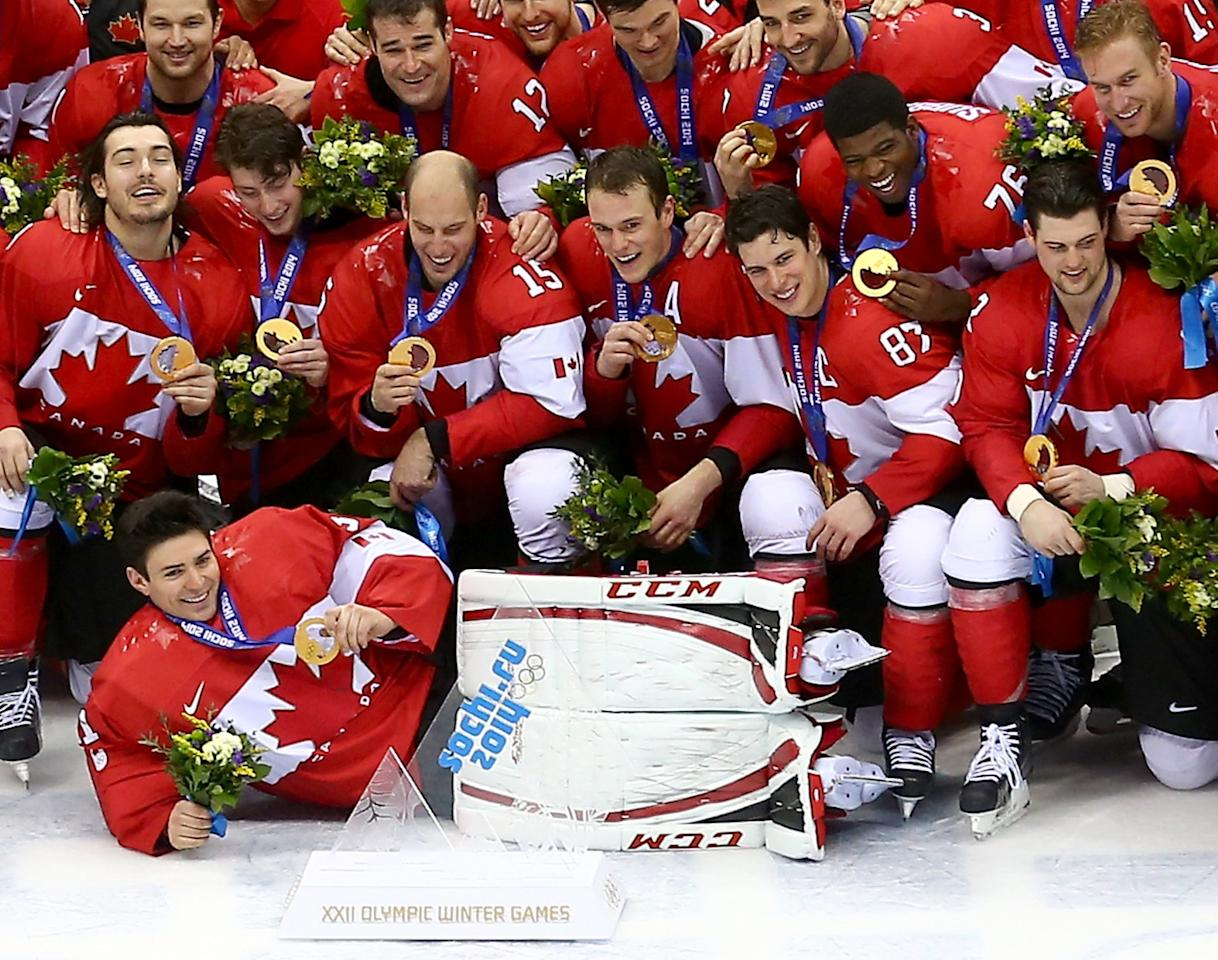 SOCHI, RUSSIA - FEBRUARY 23: The Canada team pose with the gold medals won during the Men's Ice Hockey Gold Medal match against Sweden on Day 16 of the 2014 Sochi Winter Olympics at Bolshoy Ice Dome on February 23, 2014 in Sochi, Russia. (Photo by Streeter Lecka/Getty Images)