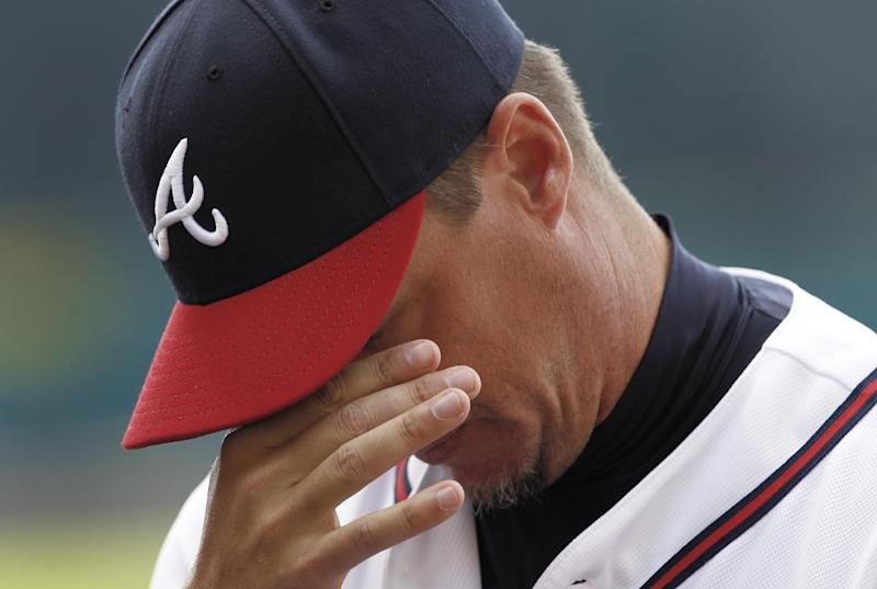 Atlanta Braves third baseman Chipper Jones announces that he will retire following the 2012 season during a news conference before a spring training baseball game against the Miami Marlins in Kissimmee, Fla., Thursday, March 22, 2012.(AP Photo/Paul Sancya)