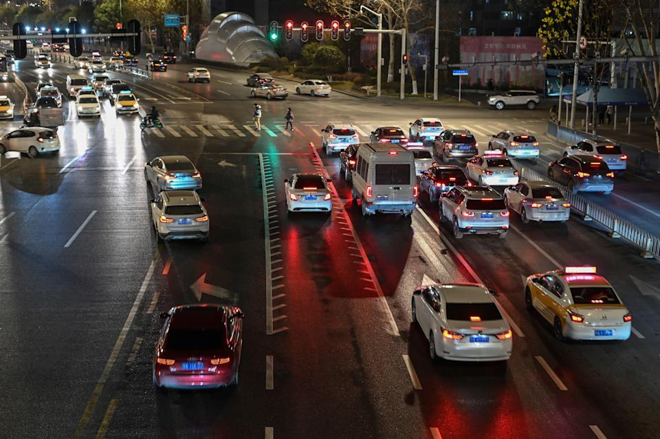 File: This photo taken on 19 January 2021 shows a general view of traffic stopped at a red light on a street in Wuhan, China (AFP via Getty Images)