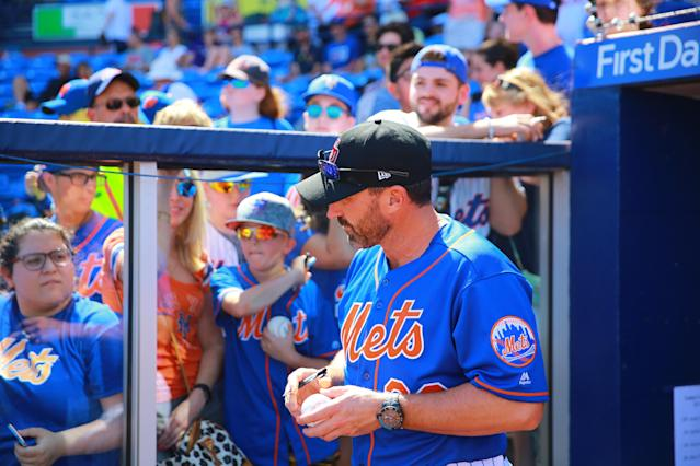 <p>New York Mets manager Mickey Callaway signs for fans before a game against the Atlanta Braves at First Data Field in Port St. Lucie, Fla., Feb. 23, 2018. (Photo: Gordon Donovan/Yahoo News) </p>