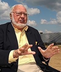 Dr. Joe Mattioli sits at the solar farm he built that has made Pocono Raceway the world's largest solar-powered sports facility