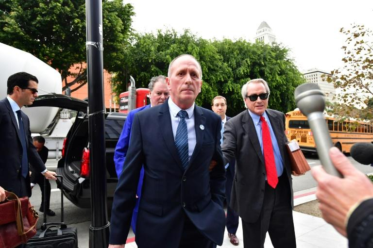 British cave diver Vernon Unsworth arrives at US District Court in Los Angeles, California on December 3, 2019 with his attorney Lin Wood (R)