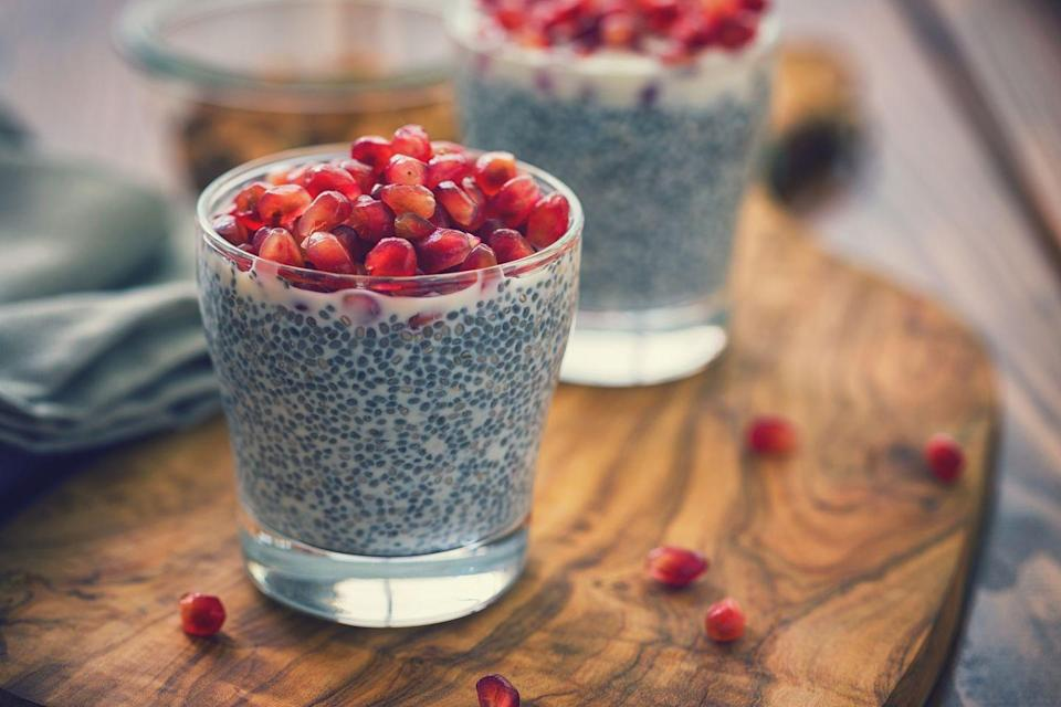 <p>Chia pudding is a healthy option for those with a sweet tooth, says Rosenbaum. To make chia pudding, Rosebaum recommends useing your choice of Whole30-compliant plant-based milk (like cashew or almond milk), chia seeds, a Medjool date, and spices like cinnamon. Blend the milk and date until it's smooth, and then pour the milk, chia seeds, and spices into a jar. Let it sit in the refrigerator for a few hours or overnight. The chia seeds will expand, soak up the milk, and thicken the mixture. Rosenbaum suggests topping the pudding off with your favorite fruit for a sweet snack.</p>