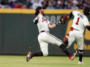 Atlanta Braves shortstop Dansby Swanson collides with second baseman Ozzie Albies as he catches a fly ball from New York Mets' Jonathan Villar during the fifth inning of a baseball game Tuesday, May 18, 2021, in Atlanta. (AP Photo/John Bazemore)