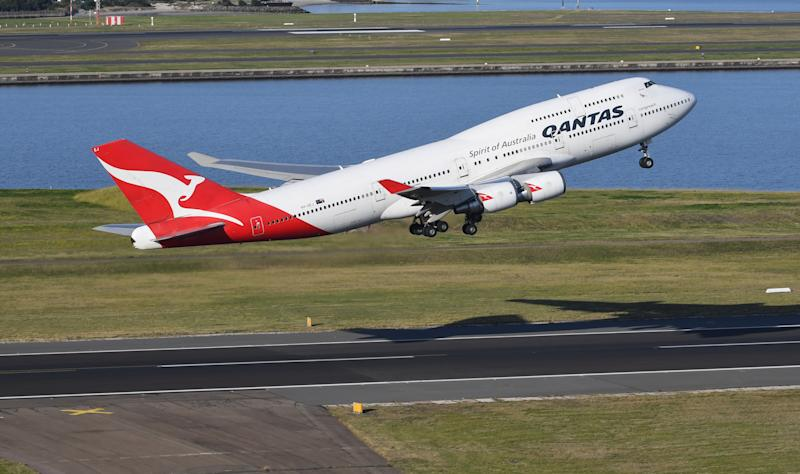 """SYDNEY, AUSTRALIA - JULY 22: A Qantas Boeing 747-400, registration VH-OEJ takes off at Sydney Airport for the last time as it retires from service on July 22, 2020 in Sydney, Australia. Flight QF7474 took off in the early afternoon to begin the fleet's early retirement from Qantas' services, which was originally scheduled in six months' time but was changed due to the devastating effects of COVID-19 on global travel. Thousands of spectators lined the airport perimeter to watch the """"Queen of the Skies"""" take off for retirement as she left for Los Angeles. (Photo by James D. Morgan/Getty Images)"""