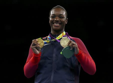 2016 Rio Olympics - Boxing - Victory Ceremony - Women's Middle (75kg) Victory Ceremony - Riocentro - Pavilion 6 - Rio de Janeiro, Brazil - 21/08/2016. Gold medallist Claressa Shields (USA) of USA poses with her medals from London 2012 and Rio 2016 (L). REUTERS/Peter Cziborra
