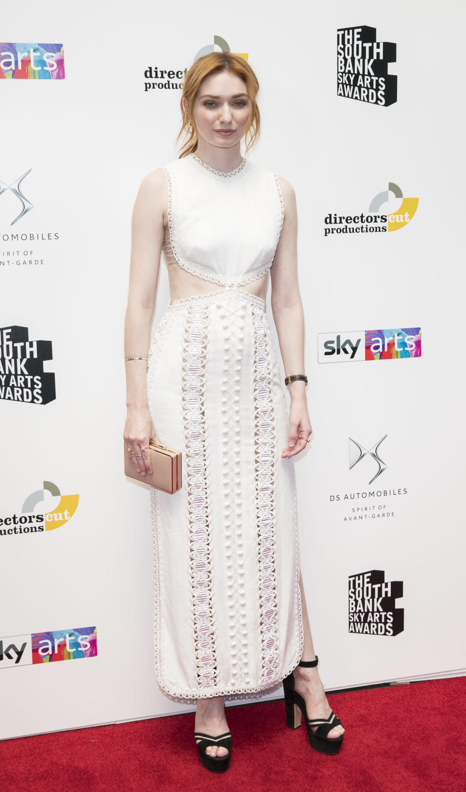 <p>Actress Eleanour Tomlinson arrived at The Southbank Sky Awards on 1 July in a summer-ready lace dress with platforms. <em>[Photo: Getty]</em> </p>