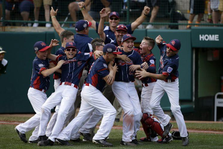 Endwell, N.Y. celebrates it's 2-1 win over South Korea in the Little League World Series Championship baseball game in South Williamsport, Pa., Sunday, Aug. 28, 2016. (AP Photo/Gene J. Puskar)
