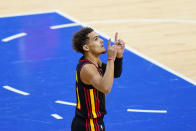 Atlanta Hawks' Trae Young reacts during Game 1 of a second-round NBA basketball playoff series against the Philadelphia 76ers, Sunday, June 6, 2021, in Philadelphia. Young became the second player in NBA history to score 30 points in each of his first four career playoff road games. The latest came in Atlanta's surprising Game 1 victory in Philadelphia. (AP Photo/Matt Slocum)