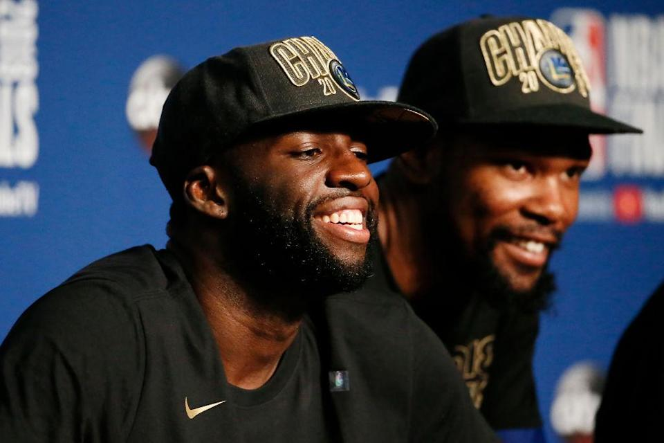 Draymond Green smiles like a man who's got his outfit for Tuesday all picked out. (Getty)