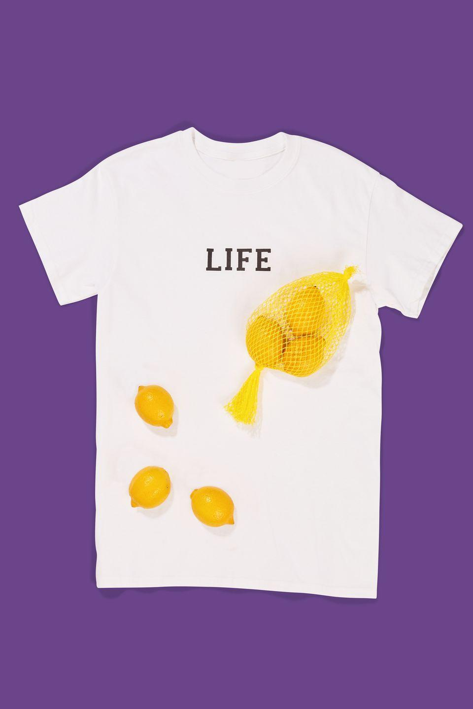 """<p> Use adhesive letters or a black Sharpie to write """"LIFE"""" on a white T-shirt, then carry around a bag of lemons to hand out. Done and done. </p><p><a class=""""link rapid-noclick-resp"""" href=""""https://www.amazon.com/SEI-3-4-Inch-Chunky-Letter-Transfer/dp/B0019D7PUA/?tag=syn-yahoo-20&ascsubtag=%5Bartid%7C10070.g.490%5Bsrc%7Cyahoo-us"""" rel=""""nofollow noopener"""" target=""""_blank"""" data-ylk=""""slk:SHOP IRON-ON LETTERS"""">SHOP IRON-ON LETTERS</a> </p>"""