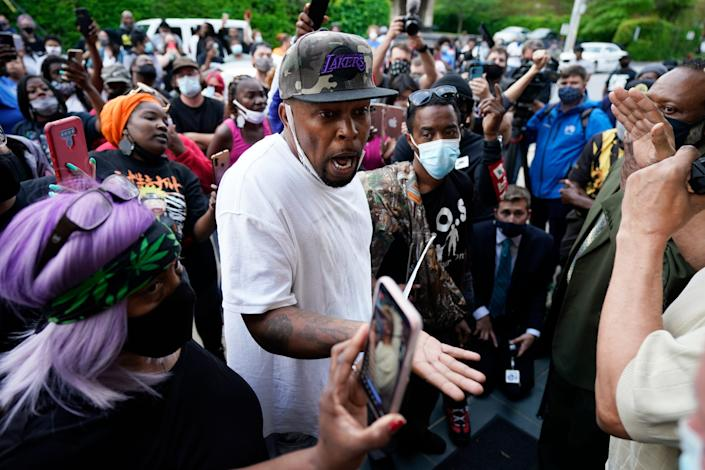 Protesters gather outside the Pasquotank County  municipal building in North Carolina on Wednesday after at least one sheriff's deputy shot and killed a Black man while executing a search warrant in Elizabeth City.