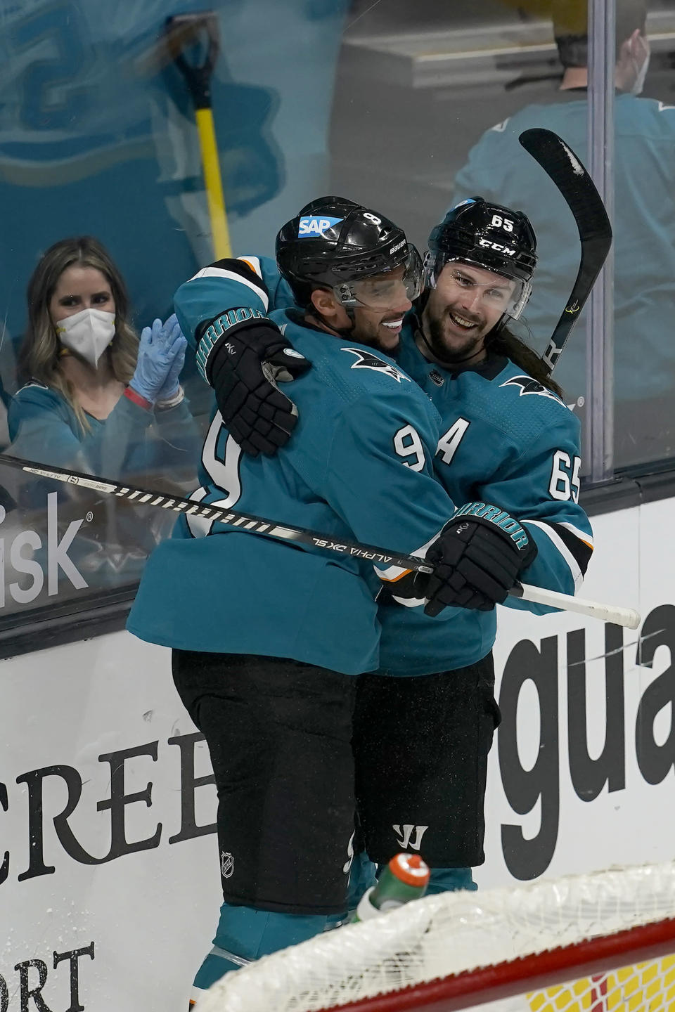 San Jose Sharks left wing Evander Kane, left, is congratulated by defenseman Erik Karlsson after scoring against the St. Louis Blues during overtime of an NHL hockey game in San Jose, Calif., Monday, March 8, 2021. (AP Photo/Jeff Chiu)