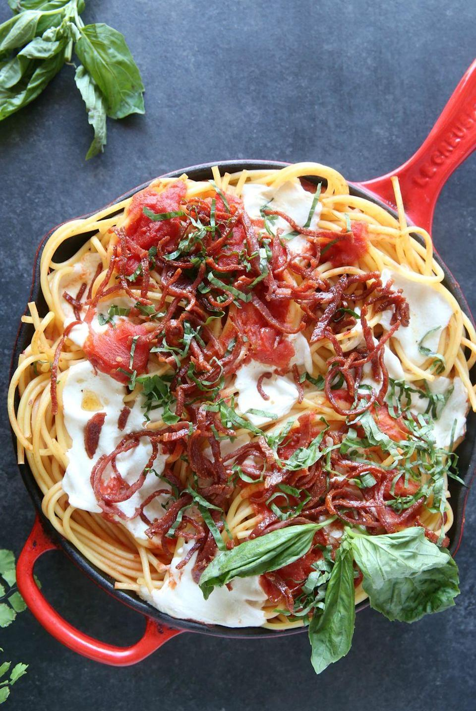 "<p>Prepare your tastebuds for pizza in pasta form.</p><p>Get the recipe from <a href=""https://www.delish.com/cooking/recipe-ideas/recipes/a47484/bucatini-with-crispy-salami-and-tomatoes-recipe/"" rel=""nofollow noopener"" target=""_blank"" data-ylk=""slk:Delish"" class=""link rapid-noclick-resp"">Delish</a>.</p>"
