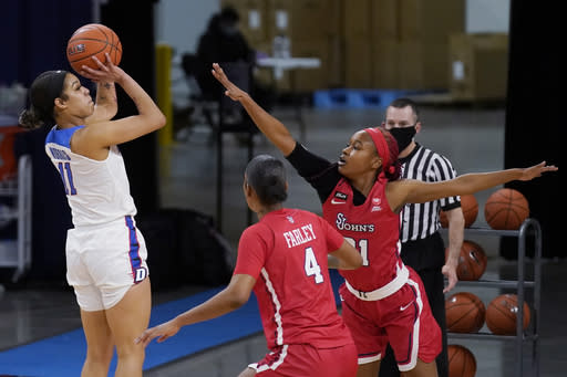 DePaul guard Sonya Morris shoots against St. John's forward Raven Farley, center, and guard Qadashah Hoppie during the first half of an NCAA college basketball game in Chicago, Wednesday, Jan. 13, 2021. (AP Photo/Nam Y. Huh)