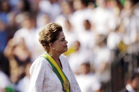 Brazil's President Dilma Rousseff stands in a vehicle during a civic-military parade to commemorate Brazil's Independence Day in Brasilia, Brazil, September 7, 2015. REUTERS/Ueslei Marcelino