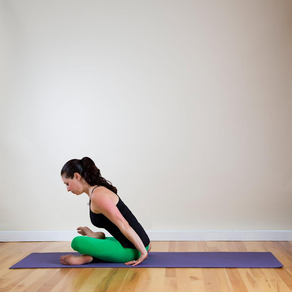 <ul> <li>Sit on the floor with your legs straight out in front of you. Bend your left knee, and place your knee, shin, and foot on the floor, so they're parallel with your pelvis. Bend your right knee, and place it on top, so your knees, shins, and ankles are stacked. You'll know you're doing it right when you gaze down and see that your legs make a little triangle.</li> <li>You may find your top knee to be high up toward the ceiling. It's OK, it just means that your hips are tight, so just stay where you are and breathe.</li> <li>To make this pose more intense, place your hands in front of your shins and walk them out as far as you can, folding your chest toward your legs.</li> <li>Stay here for one minute, slowly release, and then switch legs, so your left knee is on top.</li> </ul>