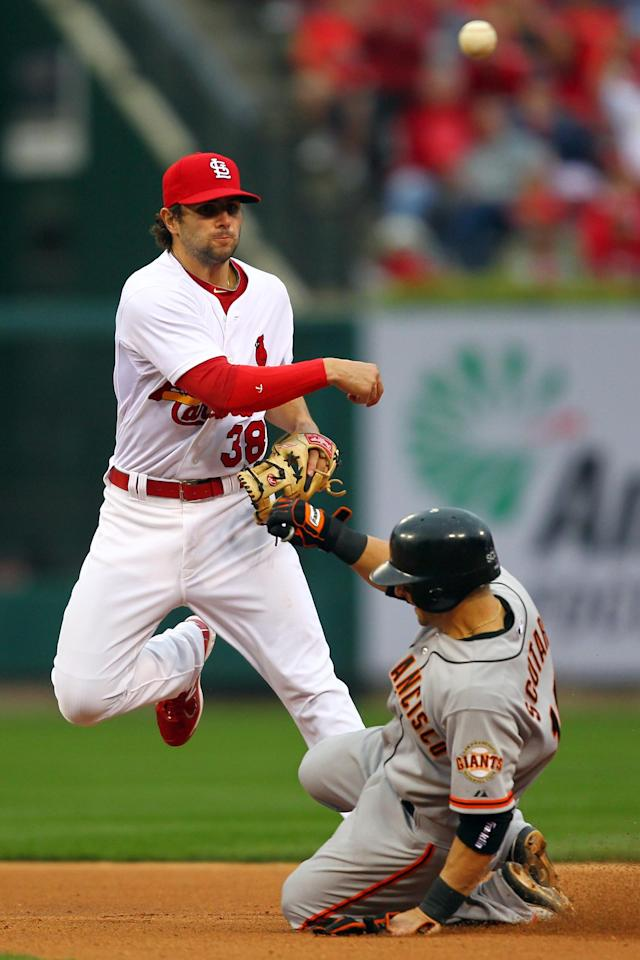 ST LOUIS, MO - OCTOBER 17: Pete Kozma #38 of the St. Louis Cardinals turns a double play as Marco Scutaro #19 of the San Francisco Giants is out at second base in the fifth inning in Game Three of the National League Championship Series at Busch Stadium on October 17, 2012 in St Louis, Missouri. (Photo by Dilip Vishwanat/Getty Images)