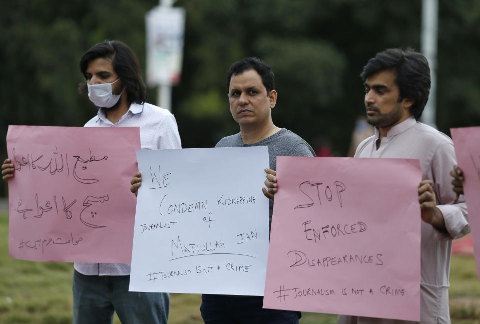 Pakistani journalists hold a demonstration to condemn the kidnaping of their colleague Matiullah Jan, in Islamabad, Pakistan, Tuesday, July 21, 2020. Jan, a prominent Pakistani journalist, known for his hard hitting criticism of the country's powerful institutions, including its military, is missing, human rights groups and a family member said Tuesday. (AP Photo/Anjum Naveed)