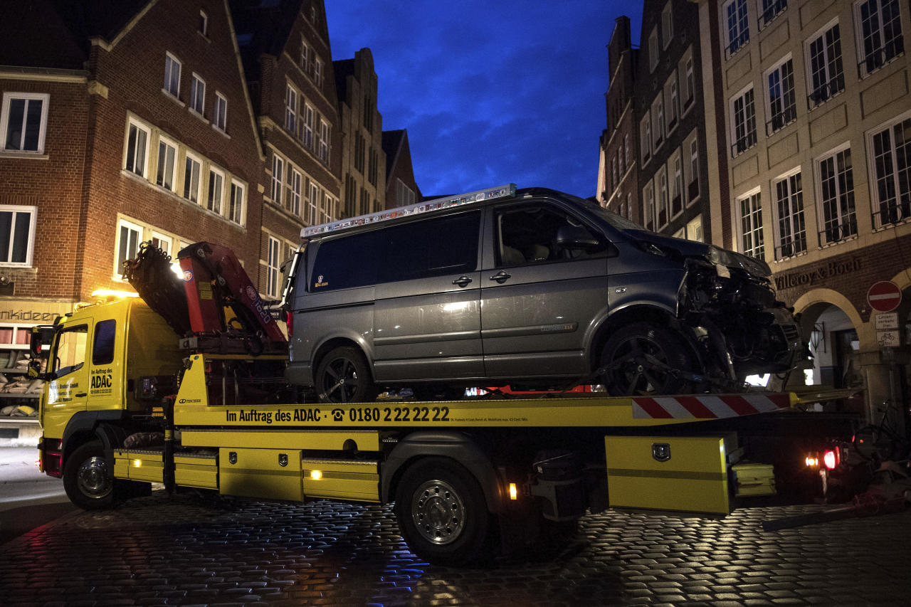 <p>A damaged van sits on the platform of a truck in Muenster, western Germany, Sunday, April 8, 2018 after the van crashed into people drinking outside a popular bar on Saturday afternoon on April 7, 2018. (Photo: Marius Becker/dpa via AP) </p>