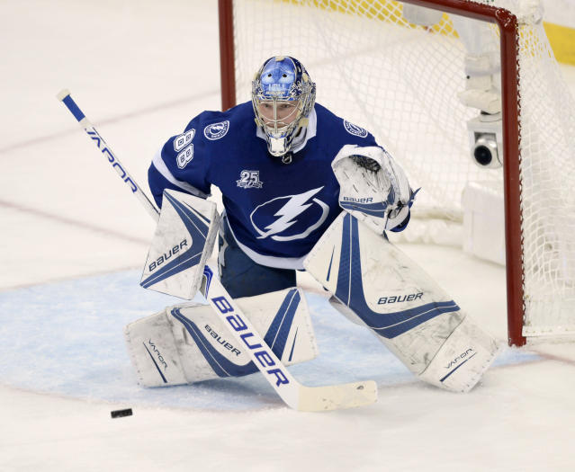 Tampa Bay Lightning goaltender Andrei Vasilevskiy (88) makes a save during the first period of Game 5 of the team's NHL hockey Eastern Conference finals against the Washington Capitals on Saturday, May 19, 2018, in Tampa, Fla. (AP Photo/Jason Behnken)