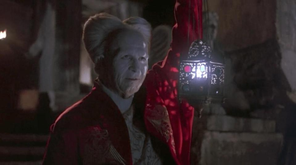 Gary Oldman's Dracula greets Harker with a lantern in his hand in Bram Stoker's Dracula.