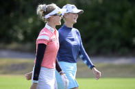 Nelly Korda, left, and her sister Jessica Korda share a laugh while walking together on the seventh fairway during the final round of the Tournament of Champions LPGA golf tournament, Sunday, Jan. 24, 2021, in Lake Buena Vista, Fla. (AP Photo/Phelan M. Ebenhack)