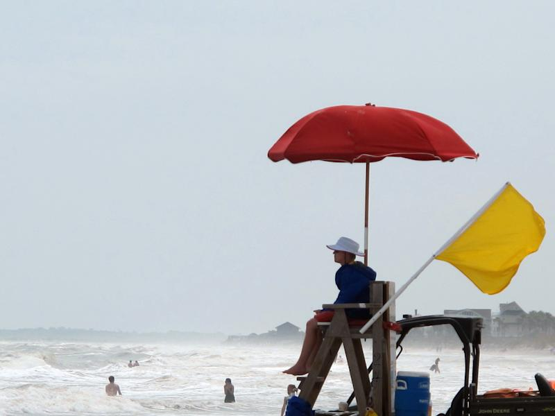 A yellow caution flag waves from a lifeguard stand at Folly Beach, S.C., on Tuesday, May 29, 2012. The National Hurricane Center forecasts the remnants of Tropical Storm Beryl will strengthen and reach tropical storm strength off the South Carolina coast on Wednesday. (AP Photo/Bruce Smith)