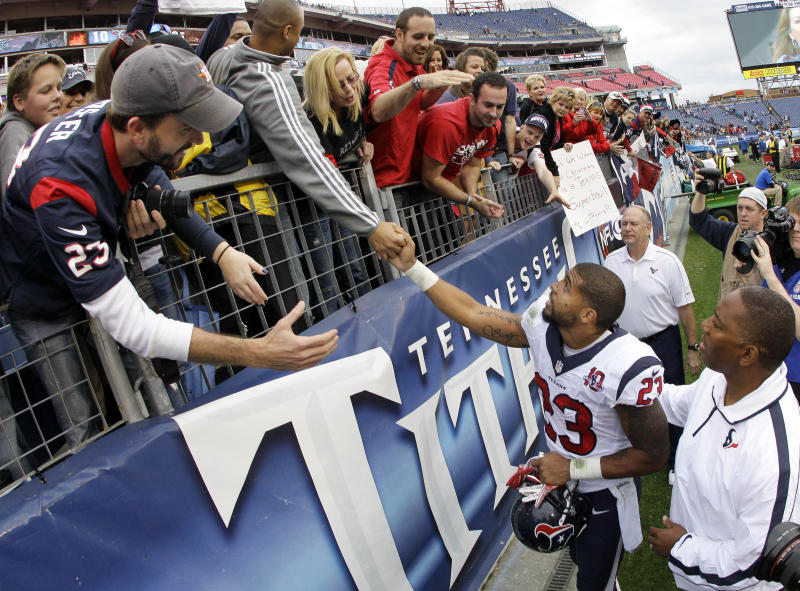 Houston Texans running back Arian Foster (23) is congratulated by fans as he leaves the field after the Texans defeated the Tennessee Titans 24-10 in an NFL football game on Sunday, Dec. 2, 2012, in Nashville, Tenn. With the win, the Texans clinched their second straight playoff berth, a franchise-record 11th win this season, and their first season sweep of The Titans. (AP Photo/Wade Payne)