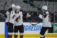 Arizona Coyotes defenseman Victor Soderstrom, center, celebrates with Jan Jenik, left, and Oliver Ekman-Larsson (23) after scoring a goal against the San Jose Sharks during the second period of an NHL hockey game Friday, May 7, 2021, in San Jose, Calif. (AP Photo/Tony Avelar)