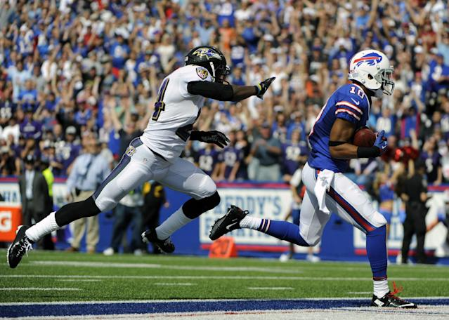 Buffalo Bills wide receiver Robert Woods (10) scores a touchdown in front of Baltimore Ravens cornerback Corey Graham (24) during the first half of an NFL football game on Sunday, Sept. 29, 2013, in Orchard Park, N.Y. (AP Photo/Gary Wiepert)