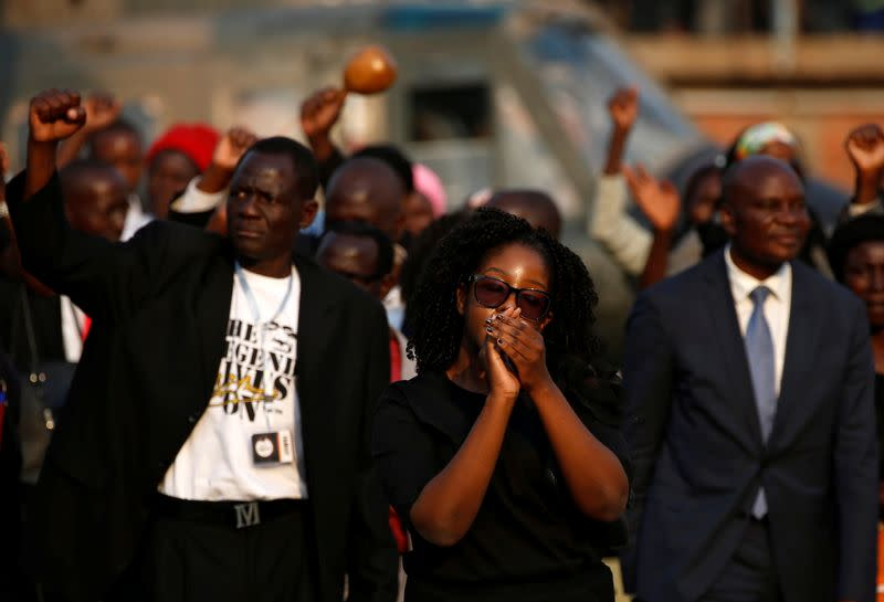 FILE PHOTO: Former Zimbabwean President Robert Mugabe's daughter, Bona Mugabe reacts as she and other family members acknowledge the crowd, before her father's casket is carried to the military chopper after lying in state at the Rufaro stadium