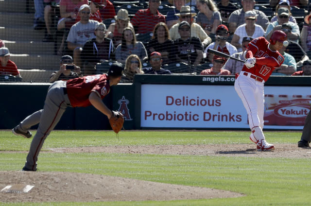 Los Angeles Angels' Shohei Ohtani, of Japan, watches his base hit off Arizona Diamondbacks pitcher Colin Poche during the sixth inning of a spring baseball game in Tempe, Ariz., Tuesday, March 20, 2018. (AP Photo/Chris Carlson)