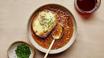 "Onions, garlic, oil, wine, and salt are all it takes to make a rich vegan broth that still evokes the classic version. And we just couldn't resist toasting some sharp cheese on bread to drop into the bowls. <a href=""https://www.bonappetit.com/recipe/french-ish-onion-soup?mbid=synd_yahoo_rss"" rel=""nofollow noopener"" target=""_blank"" data-ylk=""slk:See recipe."" class=""link rapid-noclick-resp"">See recipe.</a>"