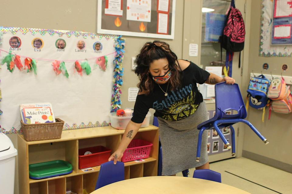 Mikaela Suniga, a toddler teacher at Open Door Preschools in Austin, prepares for an art activity. About one-third of child care providers are considering leaving or closing their program.