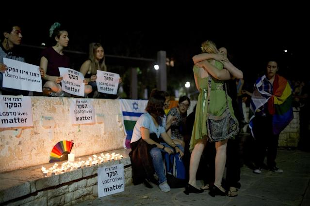 <p>Members LGBT community light candles in solidarity with Florida's shooting attack victims in Tel Aviv, Israel, June 12, 2016. (AP Photo/Oded Balilty) </p>